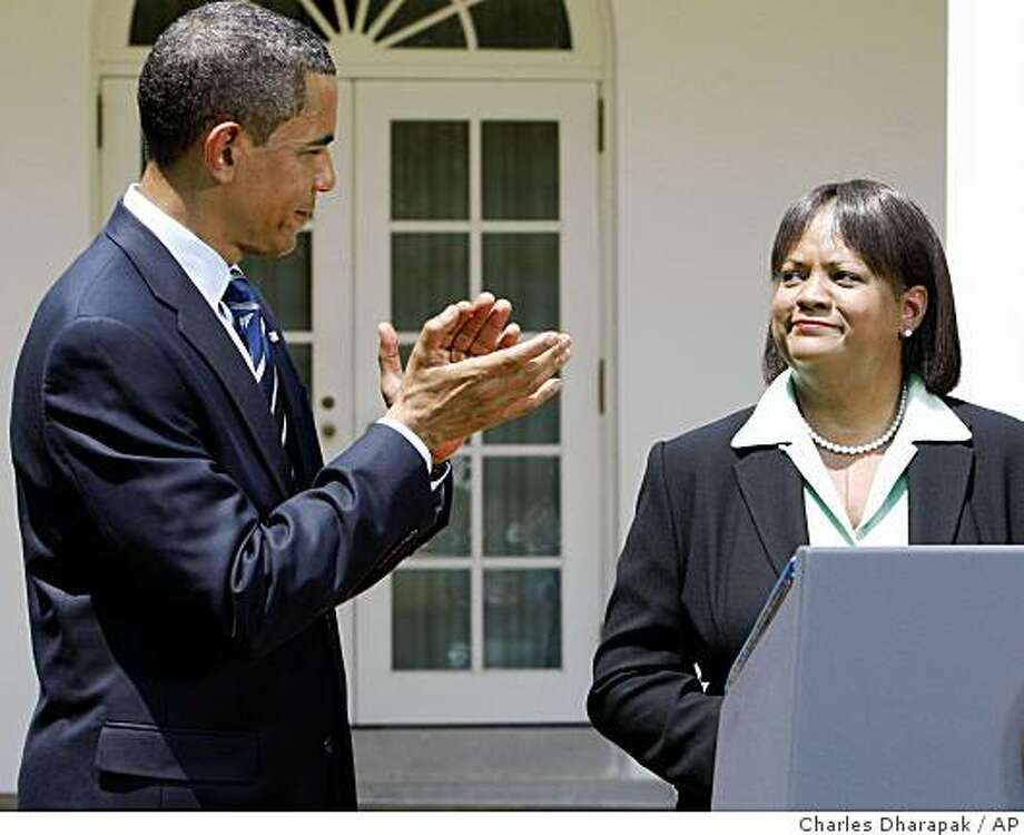 President Barack Obama applauds his nominee for Surgeon General, Dr. Regina Benjamin, in the Rose Garden of the White House in Washington, Monday, July 13, 2009. (AP Photo/Charles Dharapak) Photo: Charles Dharapak, AP