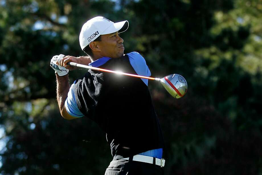PEBBLE BEACH, CA - FEBRUARY 09:  Tiger Woods hits his tee shot on the first hole during the AT&T Pebble Beach National Pro-Am at the Spyglass Hill Golf on February 9, 2012 in Pebble Beach, California.  (Photo by Jeff Gross/Getty Images) Photo: Jeff Gross, Getty Images