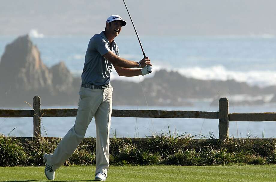 Dustin Johnson tees off on Pebble Beach Golf Links 18th hole during the opening round of the  AT&T Pebble Beach National Pro-Am golf tournament in Pebble Beach, Calif., Thursday, February 9, 2012. Photo: Lance Iversen, The Chronicle