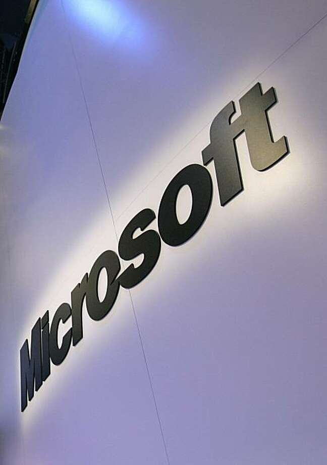 FILE - In this Jan. 10, 2009 file photo, the Microsoft logo is seen at the company's exhibit at the Consumer Electronics Show in Las Vegas. Microsoft Corp. is giving a select group of technology-savvy testers an early peek at Office 2010, but it's still keeping Web-based versions of Word, Excel and its other go-to programs under wraps. (AP Photo/Paul Sakuma, file) Photo: Paul Sakuma, AP