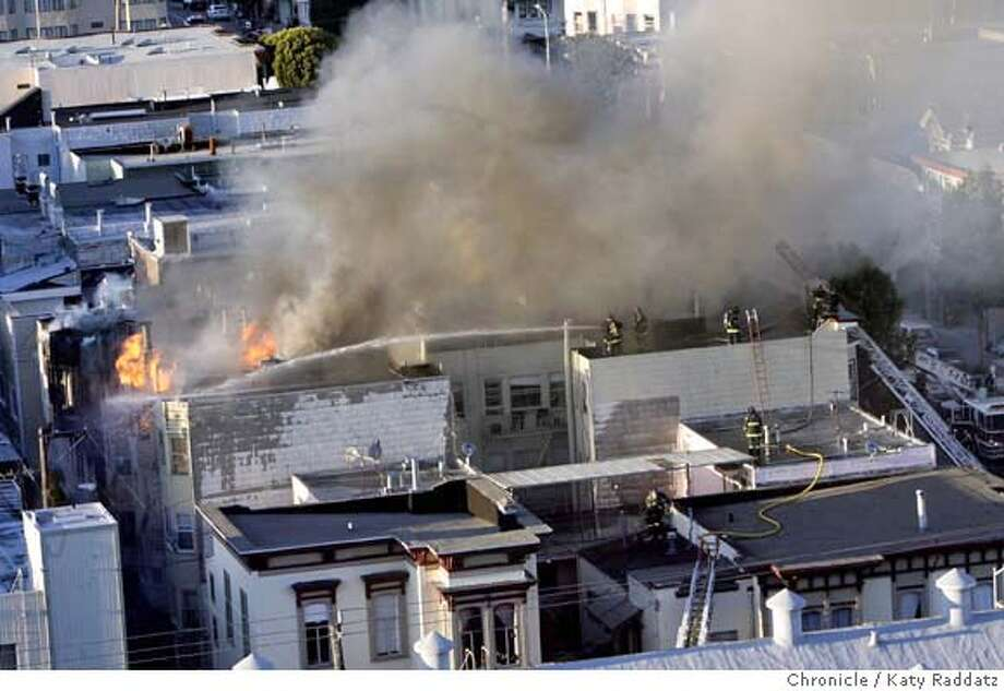 A fire that is centered at 1470 Valencia St. consumes many buildings in the 1400 block, including the Dovre Club, in San Francisco, Calif. on Monday March 17, 2008.  Photo by Katy Raddatz / San Francisco Chronicle Photo: KATY RADDATZ
