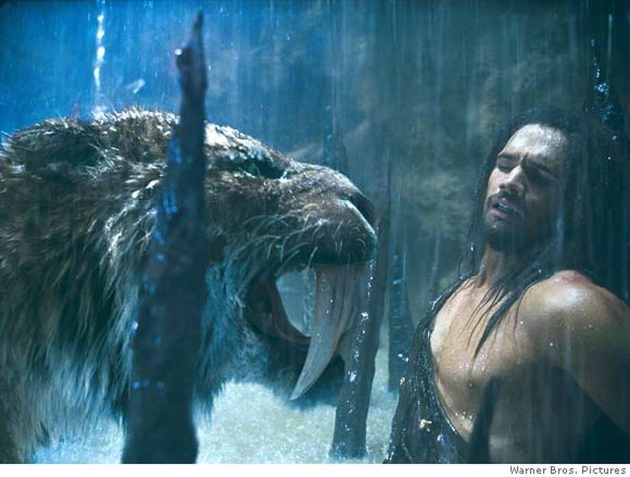 "STEVEN STRAIT as D'Leh is threatened by a saber-tooth tiger in a scene from Warner Bros. Pictures' and Legendary Pictures' epic adventure ""10,000 B.C.,"" distributed by Warner Bros. Pictures.  PHOTOGRAPHS TO BE USED SOLELY FOR ADVERTISING, PROMOTION, PUBLICITY OR REVIEWS OF THIS SPECIFIC MOTION PICTURE AND TO REMAIN THE PROPERTY OF THE STUDIO. NOT FOR SALE OR REDISTRIBUTION. ALL RIGHTS RESERVED. Photo: Courtesy Of Warner Bros. Picture"