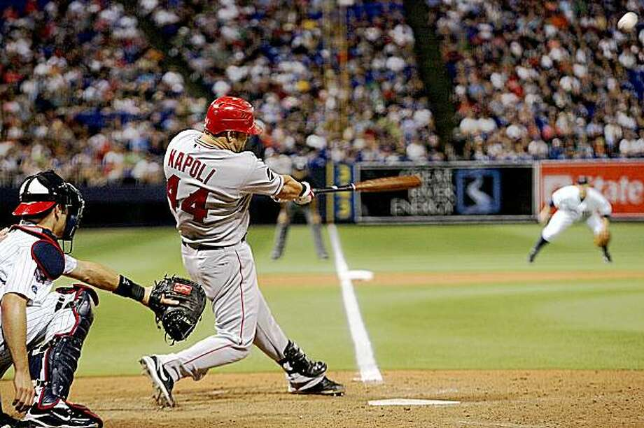 Los Angeles Angels' Mike Napoli connects on a home run in the eighth inning off Minnesota Twins pitcher Matt Guerrier during a baseball game in Minneapolis on Friday, July 31, 2009. (AP Photo/Andy King) Photo: Andy King, AP