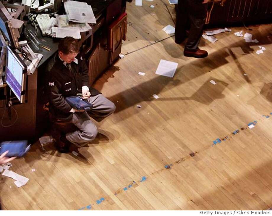 ###Live Caption:NEW YORK - MARCH 14: A trader sits and works near the end of the trading day at the New York Stock Exchange March 14, 2008 in New York City. Stocks tumbled after news of a planned government bailout of Bear Stearns Co. gave fears that the credit crisis is continuing. (Photo by Chris Hondros/Getty Images)###Caption History:NEW YORK - MARCH 14: A trader sits and works near the end of the trading day at the New York Stock Exchange March 14, 2008 in New York City. Stocks tumbled after news of a planned government bailout of Bear Stearns Co. gave fears that the credit crisis is continuing. (Photo by Chris Hondros/Getty Images)###Notes:Stocks Close Down on Credit Fears###Special Instructions: Photo: Chris Hondros