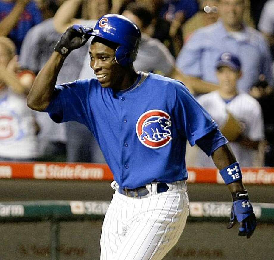 Chicago Cubs' Alfonso Soriano begins to celebrate with his teammates at home plate after he hit a grand slam off Houston Astros relief pitcher Chris Sampson, giving the Cubs a 5-1 win in the 13th inning of a baseball game Monday, July 27, 2009, at Wrigley Field in Chicago. (AP Photo/Charles Rex Arbogast) Photo: Charles Rex Arbogast, AP