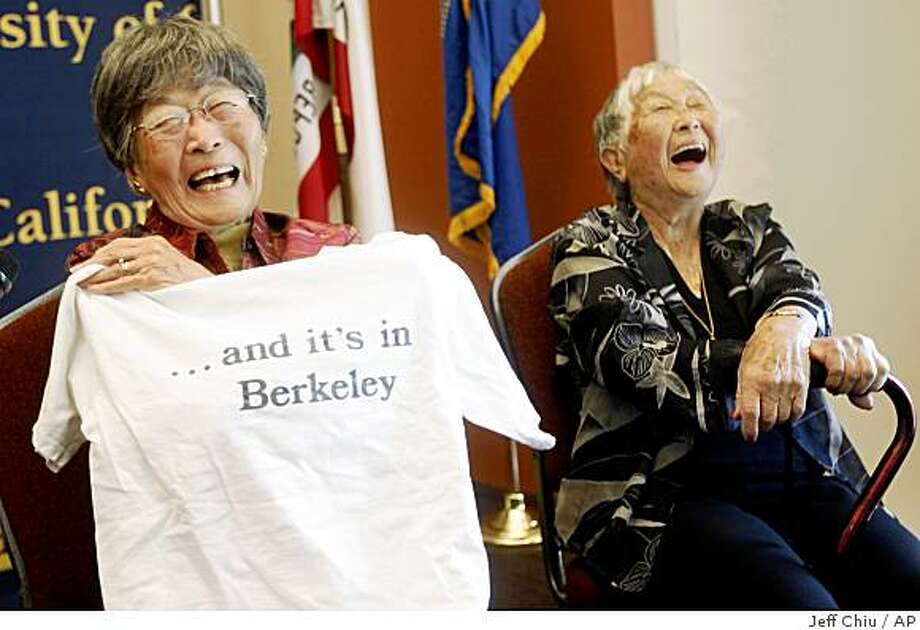 "Aiko ""Grace"" Obata Amemiya, left, laughs with Taye Oda while holding up a UC Berkeley shirt after speaking to the University of California Board of Regents in San Francisco, Thursday, July 16, 2009. The University of California will grant honorary degrees to hundreds of Japanese Americans whose studies at UC were interrupted when they were sent to internment camps during World War II. (AP Photo/Jeff Chiu) Photo: Jeff Chiu, AP"