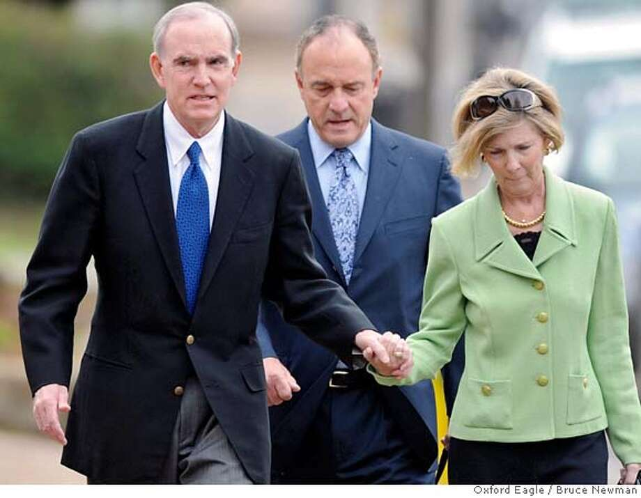 "###Live Caption:Richard ""Dickie"" Scruggs, left, his attorney John Keker, center, and his wife Diane Scruggs enter federal court in Oxford, Miss. on Friday, March 14, 2008. He and a co-defendant pleaded guilty to conspiracy to bribe a judge. (AP Photo/Oxford Eagle, Bruce Newman)###Caption History:Richard ""Dickie"" Scruggs, left, his attorney John Keker, center, and his wife Diane Scruggs enter federal court in Oxford, Miss. on Friday, March 14, 2008. He and a co-defendant pleaded guilty to conspiracy to bribe a judge. (AP Photo/Oxford Eagle, Bruce Newman)###Notes:SCRUGGS KEKER SCRUGGS###Special Instructions:MAGS OUT NO SALES Photo: Bruce Newman"