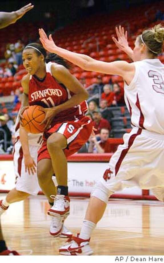 Stanford guard Candice Wiggins drives in front of Washington State center Heather Molzen (31) during the first half of a college basketball game Sunday, March 2, 2008, in Pullman, Wash. (AP Photo/Dean Hare) Photo: Dean Hare