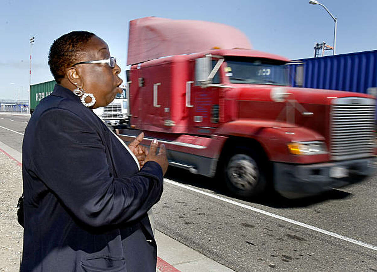 Oakland activist Margaret Gordon has been fighting for better air in West Oakland for decades. She watches as a truckl rushes by at the Port of Oakland. State and local air quality officials are funneling $22 million into a program to retrofit the emissions systems on the trucks that move in and out of the Port of Oakland each day.