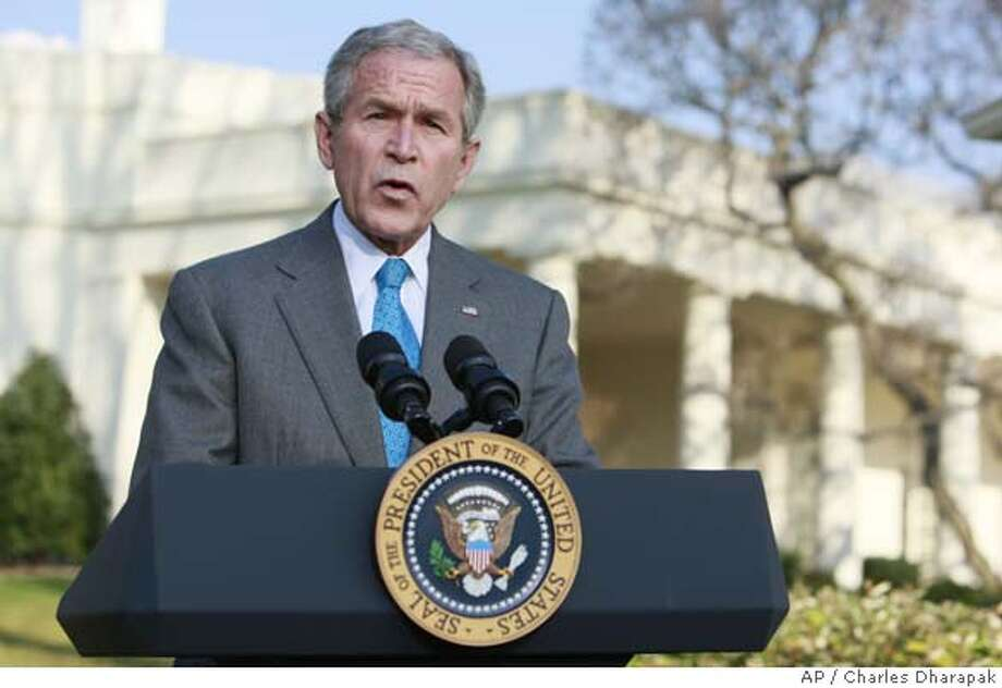 ###Live Caption:President Bush makes a statement on FISA (Foreign Intelligence Surveillance Act) legislation, Thursday, March 13, 2008, on the South Lawn of the White House in Washington. (AP Photo/Charles Dharapak)###Caption History:President Bush makes a statement on FISA (Foreign Intelligence Surveillance Act) legislation, Thursday, March 13, 2008, on the South Lawn of the White House in Washington. (AP Photo/Charles Dharapak)###Notes:George W. Bush###Special Instructions: Photo: Charles Dharapak