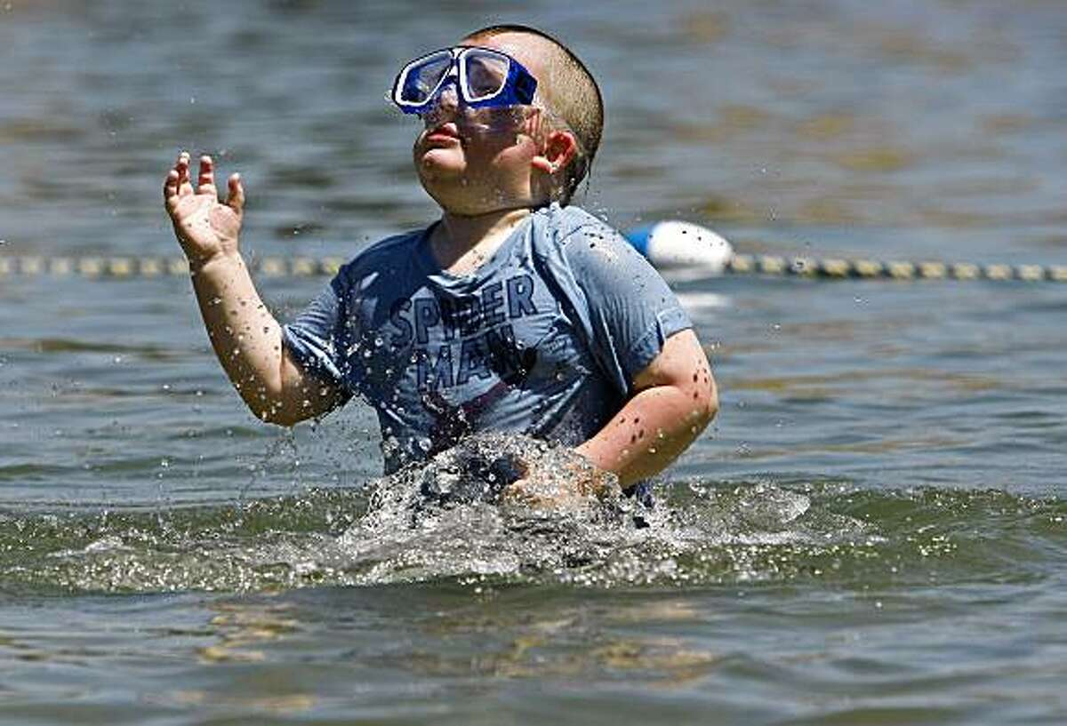 4-year-old Cooper Kawalkowski, of Concord comes up for air from the cool waters of Shadow Cliffs Regional Park in Pleasanton, Calif., on Tuesday July 14, 2009, where the temperatures were expected to reach of high of 102 degrees today.