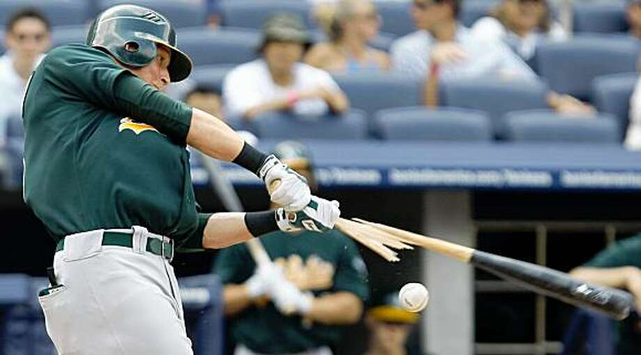 Oakland Athletics' Ryan Sweeney breaks his bat on a foul ball against the New Yankees in the eighth inning of a baseball game in New York, Sunday, July 26, 2009. The Yankees won 7-6. (AP Photo/Kathy Willens) Photo: Kathy Willens, AP