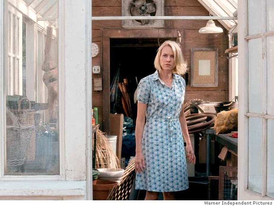 """Naomi Watts in FUNNY GAMES """"exclusive to SF Chronicle"""" Ran on: 03-09-2008  Naomi Watts plays a woman whose family is terrorized by psychopaths in &quo;Funny Games,&quo; a remake of a 1997 German-language film. Photo: Warner Independent Pictures"""