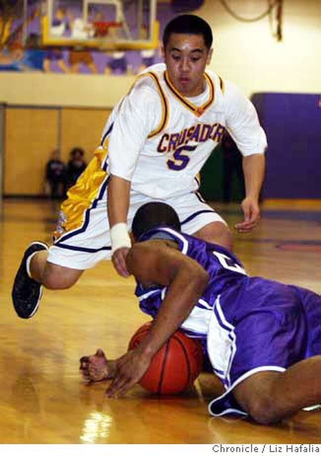 ###Live Caption:Boys high school basketball: Northern California Div. III semifinal. Sacramento @ Riordan. Riordans' #5 guard Brian Miguel and Sacramento's #23 Denzel Pruitt grappling for the ball during the first half of the game in San Francisco, Calif., on thursday,Mar. 3, 2008. Photo by Liz Hafalia/San Francisco Chronicle###Caption History:Boys high school basketball: Northern California Div. III semifinal. Sacramento @ Riordan. Riordans' #5 guard Brian Miguel and Sacramento's #23 Denzel Pruitt grappling for the ball during the first half of the game in San Francisco, Calif., on thursday,Mar. 3, 2008. Photo by Liz Hafalia/San Francisco Chronicle###Notes:Boys high school basketball: Northern California Div. III semifinal. Sacramento @ Riordan. Riordans' #5 guard Brian Miguel and Sacramento's #23 Denzel Pruitt grappling for the ball during the first half of the game in San Francisco, Calif., on Mar. 3,###Special Instructions:�2008, San Francisco Chronicle/ Liz Hafalia  MANDATORY CREDIT FOR PHOTOG AND SAN FRANCISCO CHRONICLE. NO SALES- MAGS OUT. Photo: Liz Hafalia
