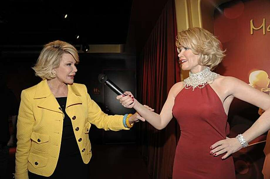 In this handout photo courtesy of Madame Tussauds Hollywood, comedienne Joan Rivers touches a wax figure of herself while touring Madame Tussauds Hollywood in Los Angeles on Monday, July 27, 2009. (AP Photo/Madame Tussauds Hollywood, Dan Steinberg) Photo: Dan Steinberg, AP