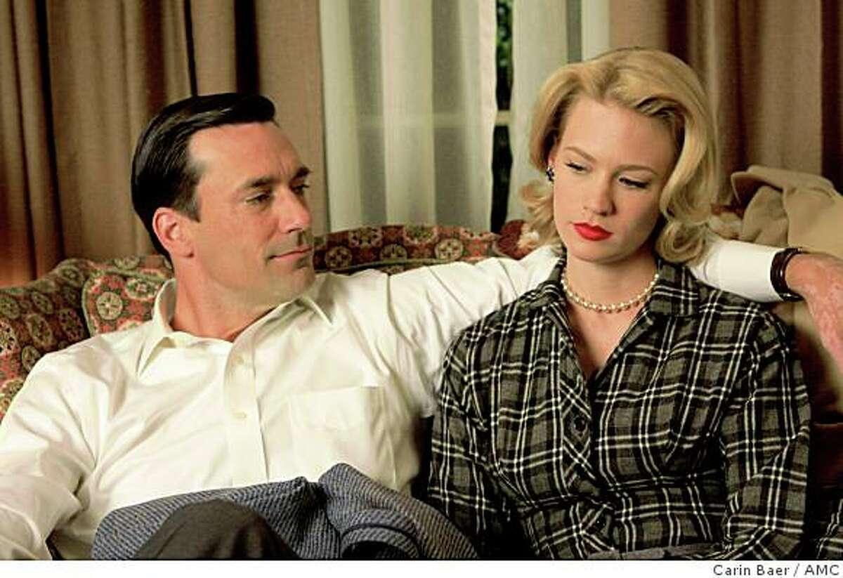 Don Draper (Jon Hamm) and wife Betty Draper (January Jones) in AMC's Mad Men.