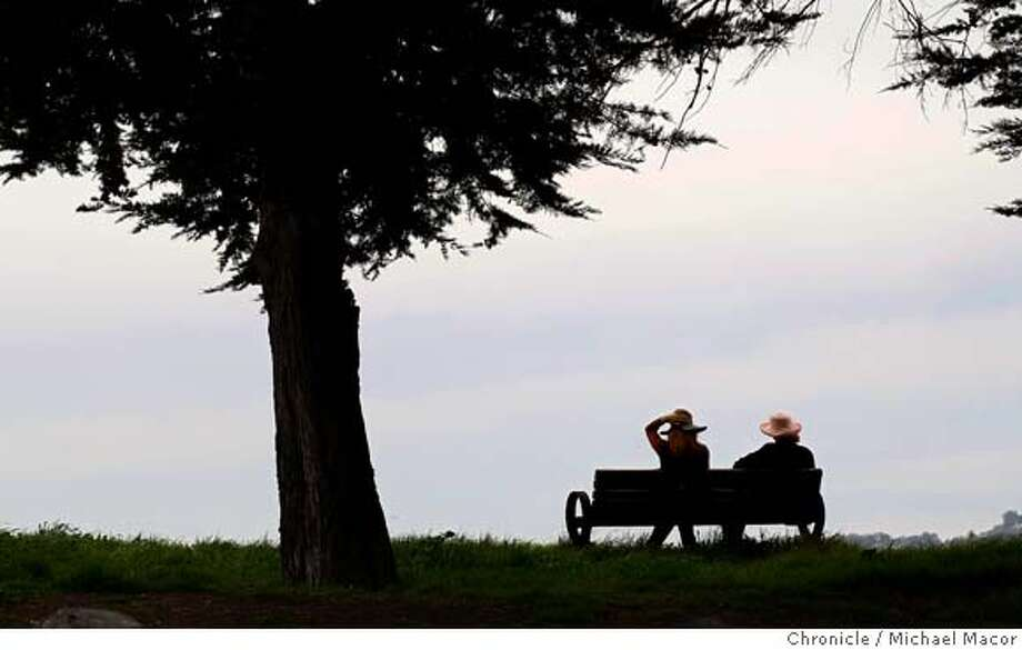 Keep your hat on. Sisters, Marilyn, left, and Judith Goldhaber of Berkeley, Calif., take a break at a park bench at the edge of Cesar Chavez Park under partly cloudy skies today, March 6, 2008. Photo by Michael Macor/ San Francisco Chronicle Photo: Michael Macor