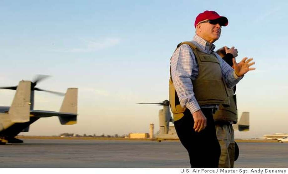 In this image released by the U.S. Air Force, Sen. John McCain is seen at Baghdad's International Airport to visit the top U.S. commander in Iraq, Gen. David Petraeus, Baghdad, Iraq, Sunday, March 16, 2008. McCain, the likely Republican presidential nominee who has linked his political future to U.S. success in Iraq, was in Baghdad on Sunday for meetings with Iraqi and U.S. diplomatic and military officials, a U.S. government official said. (AP Photo/U.S. Air Force, Master Sgt. Andy Dunaway, HO) Photo: MASTER SGT. ANDY DUNAWAY