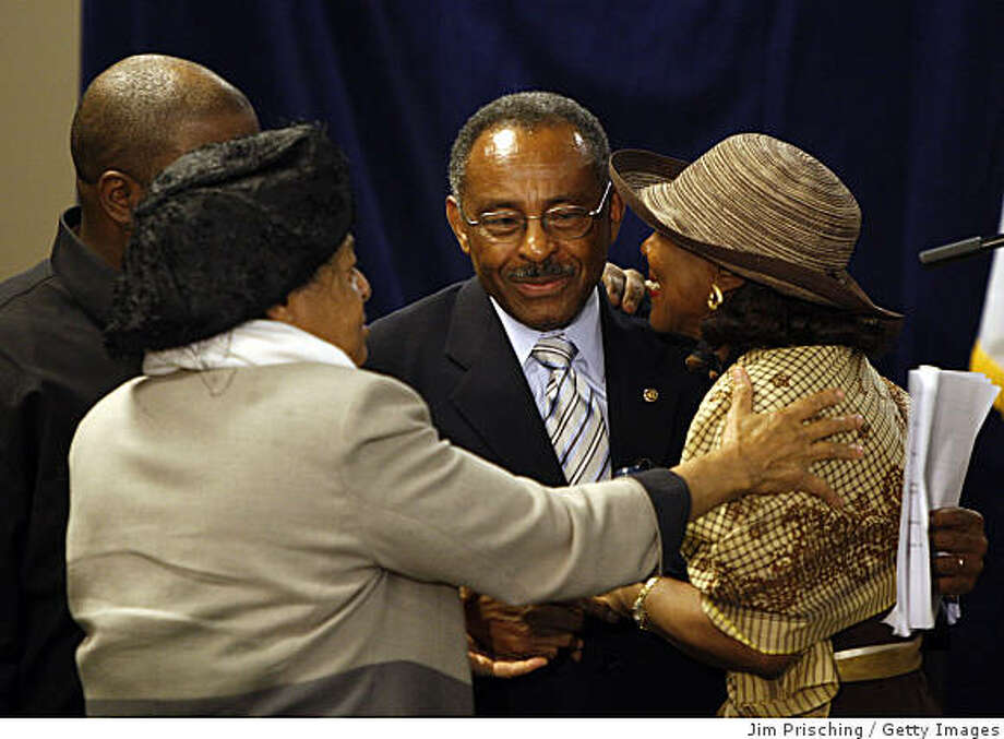CHICAGO - JULY 10:  U.S. Senator Roland Burris (D-IL) hugs supporters after announcing he will not run in the 2010 election on July 10, 2009 in Chicago, Illinois. Burris was appointment by ousted former Illinois Governor Rod Blagojevich to the Senate after President Obama vacated his seat in January 2009.  (Photo by Jim Prisching/Getty Images) Photo: Jim Prisching, Getty Images