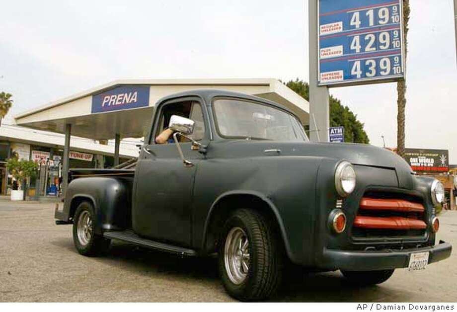 ###Live Caption:With gas prices in the background past the $4.00 dollars mark, a motorist drives away before filling up his 1954 Ford truck in Los Angeles, Wednesday, March 12, 2008. Gasoline and oil prices extended their record-setting streaks Wednesday, with gas at the pump reaching a new high of nearly $3.25 and crude surpassing $110 for the first time. (AP Photo/Damian Dovarganes)###Caption History:With gas prices in the background past the $4.00 dollars mark, a motorist drives away before filling up his 1954 Ford truck in Los Angeles, Wednesday, March 12, 2008. Gasoline and oil prices extended their record-setting streaks Wednesday, with gas at the pump reaching a new high of nearly $3.25 and crude surpassing $110 for the first time. (AP Photo/Damian Dovarganes)###Notes:###Special Instructions: Photo: Damian Dovarganes