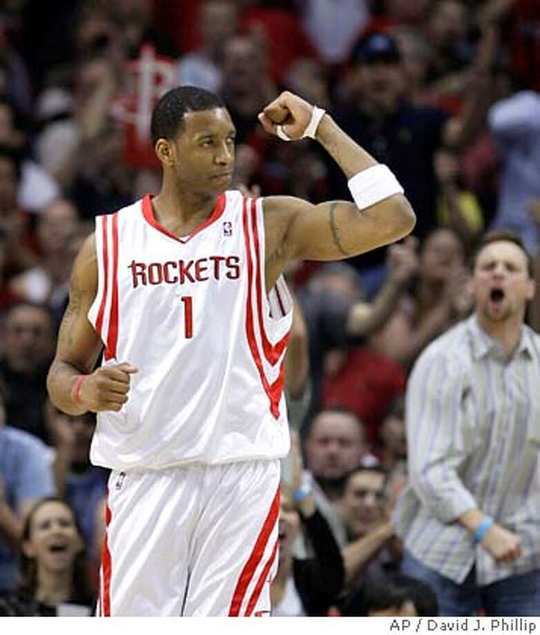 ###Live Caption:Houston Rockets' Tracy McGrady reacts after making a basket while being fouled by the Charlotte Bobcats during the first quarter of a basketball game Friday, March 14, 2008, in Houston. (AP Photo/David J. Phillip)###Caption History:Houston Rockets' Tracy McGrady reacts after making a basket while being fouled by the Charlotte Bobcats during the first quarter of a basketball game Friday, March 14, 2008, in Houston. (AP Photo/David J. Phillip)###Notes:Tracy McGrady###Special Instructions:EFE OUT Photo: David J. Phillip