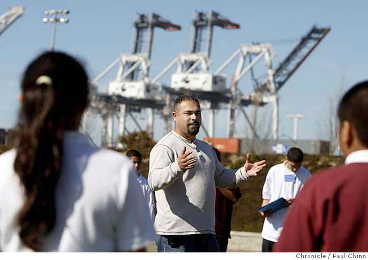 ###Live Caption:Teamsters organizer Sal Abrica speaks to students from St. Martin de Porres Middle School at Middle Harbor Park in Oakland, Calif., on Thursday, Feb. 28, 2008. The students were on a field trip to the Port of Oakland organized by a coalition of community groups. The trip focused on the rising cases of health problems in the neighborhood, including asthma, caused in large part by pollutants from trucks waiting to pick up cargo at the port. Photo by Paul Chinn / San Francisco Chronicle###Caption History:Teamsters organizer Sal Abrica speaks to students from St. Martin de Porres Middle School at Middle Harbor Park on a field trip to the Port of Oakland organized by a coalition of community groups in Oakland, Calif., on Thursday, Feb. 28, 2008. The trip focused on the rising cases of health problems in the neighborhood, including asthma, caused in large part by pollutants from trucks waiting to pick up cargo at the port. Photo by Paul Chinn / San Francisco Chronicle###Notes:Sal Abrica###Special Instructions:MANDATORY CREDIT FOR PHOTOGRAPHER AND S.F. CHRONICLE/NO SALES - MAGS OUT