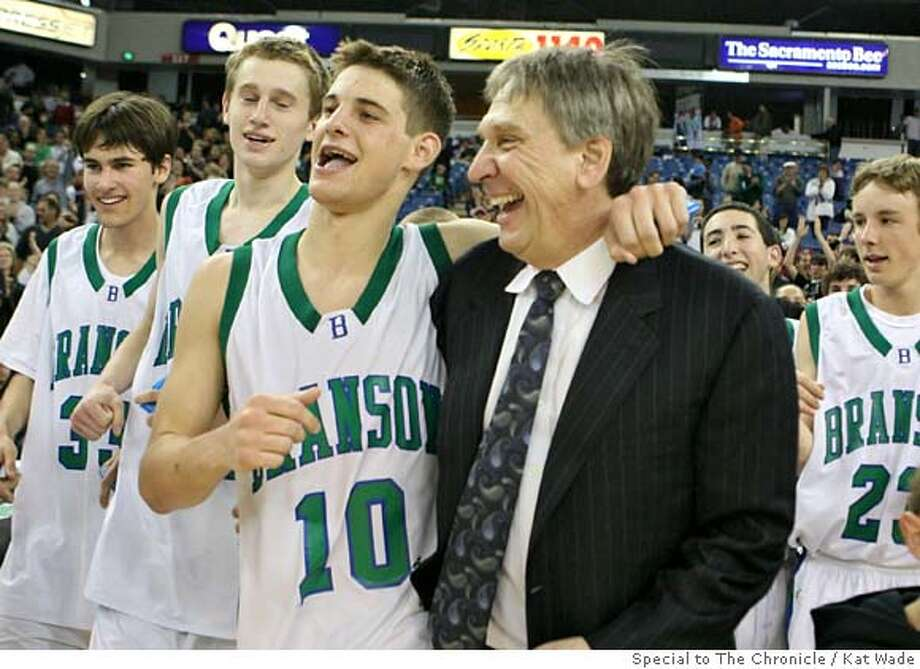 With his arm around his star player, Oliver McNally, Branson, Ross Bulls head coach Jonas Honick, right, and other team members go up to receive their trophy after Branson wins the Boys Division V State Championship against the Renaissance Academy Wildcats 40 to 33 at the ARCO arena in Sacramento, Calif. on Saturday, March 15, 2008.  Photo by Kat Wade / Special to the Chronicle Photo: Kat Wade