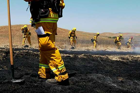 DUBLIN, CA - JUNE 24:  Firefighters from San Francisco, California use hand tools to make a fire break during a multi-agency wildfire training drill June 24, 2009 in Dublin, California. Fire departments from several San Francisco Bay Area counties participated in a live-fire wildfire drill as fire crews gear up for what is expected to be a busy summer as California continues to experience a drought.  (Photo by Justin Sullivan/Getty Images)