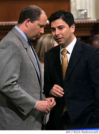 California assembly Minority Leader Mike Villines, R-Clovis, left, confers with Assembly Speaker Fabian Nunez, D-Los Angeles, as the Assembly debates a measure that would levy taxes on oil companies, at the Capitol in Sacramento, Calif., Wednesday, March 12, 2008. The measure, by Nunez, would tax petroleum companies 6 percent on the oil they extract in the state. Republicans opposed the measure which requires a two-thirds vote for passage. (AP Photo/Rich Pedroncelli) Photo: Rich Pedroncelli