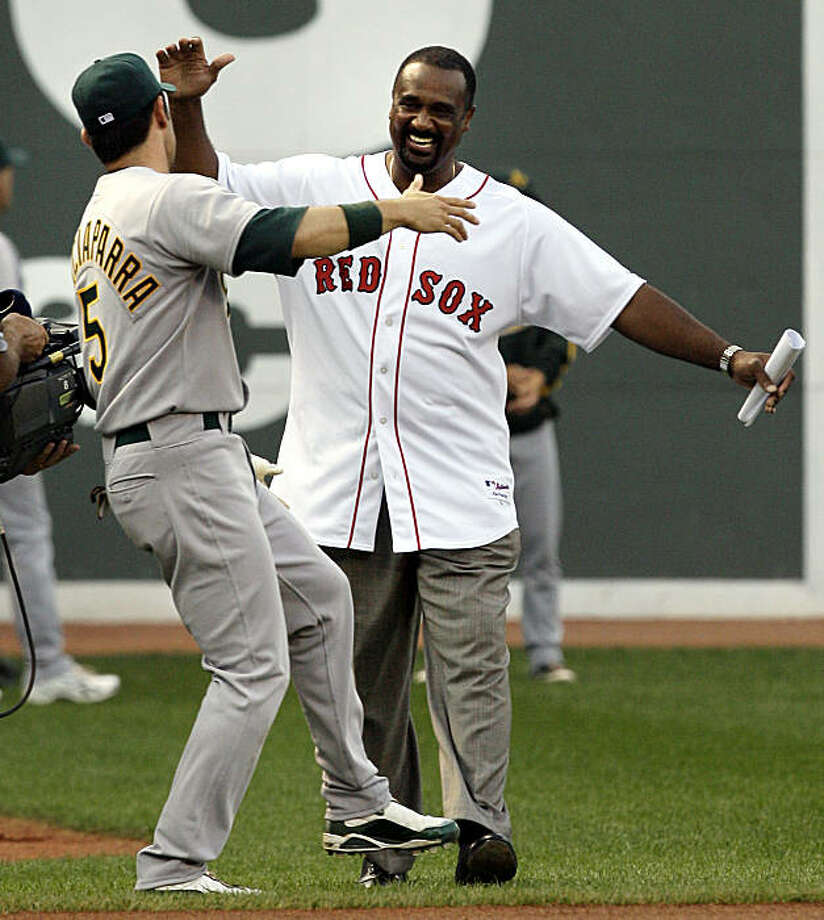 Jim Rice, right, a former Boston Red Sox player recently inducted into the Baseball Hall of Fame, is greeted by former Red Sox and current Oakland Athletics player Nomar Garciaparra during ceremonies to retire Rice's No. 14 at Fenway Park in Boston on Tuesday, July 28, 2009. Photo: Elise Amendola, AP