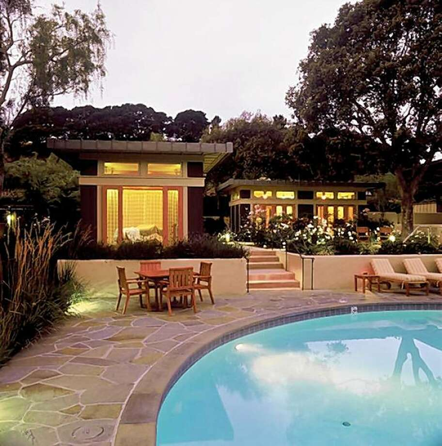 The lush landscaping of Quail Lodge in Carmel Valley  is reflected in the swimming pool in the evening light. Photo: Courtesy, Quail Lodge