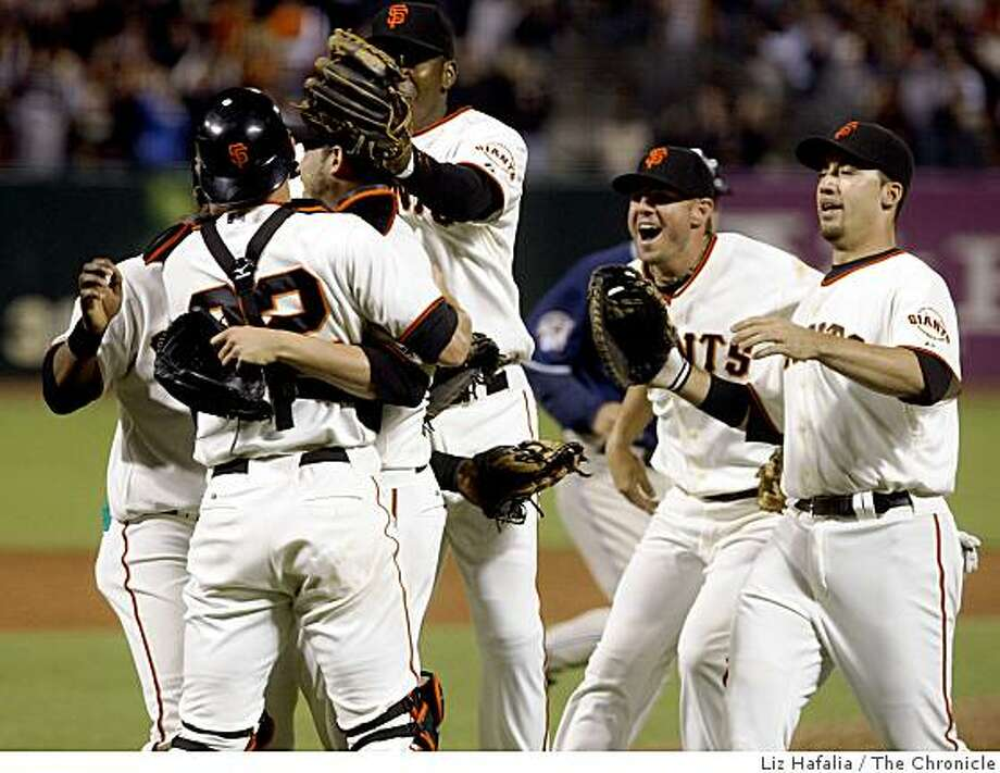 Jonathan Sanchez is mobbed by his teammates after he pitched a no-hitter at AT&T Park in San Francisco, Calif., on Friday, July 10, 2009. Photo: Liz Hafalia, The Chronicle