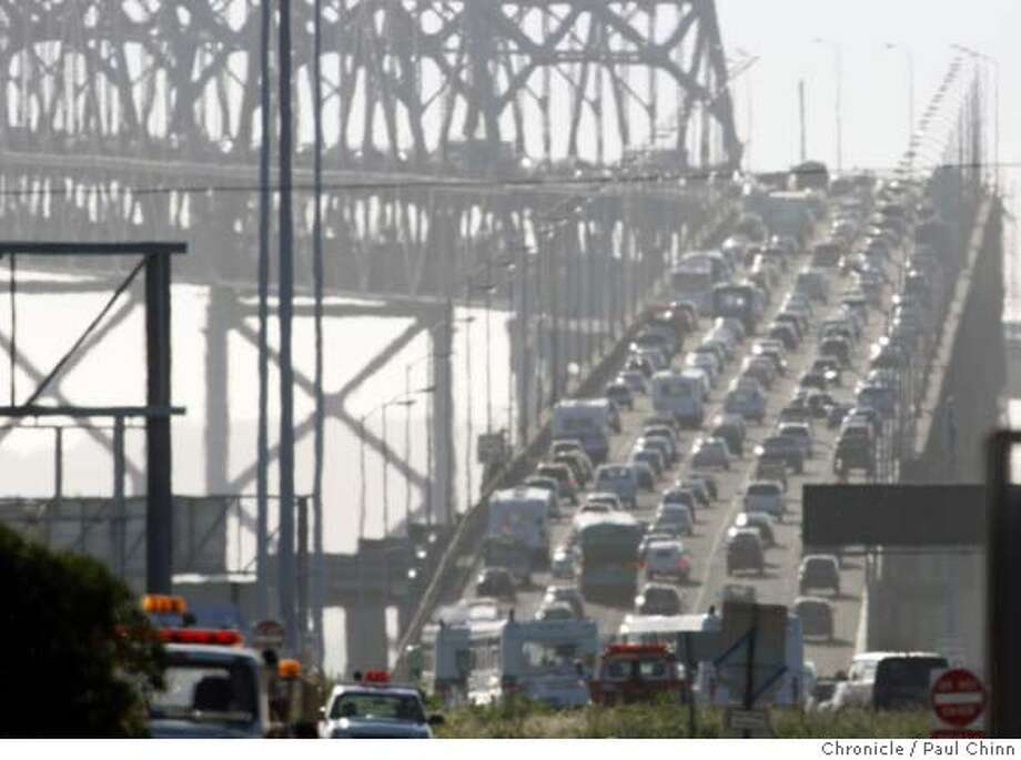 Westbound traffic on the Bay crawls up the incline section after a jackknifed big rig blocked several lanes of the eastern span in Oakland, Calif., on Tuesday, March 4, 2008. The accident, which took about an hour to clear, backed up the afternoon commute for several miles in the East Bay.  Photo by Paul Chinn / San Francisco Chronicle Photo: Paul Chinn