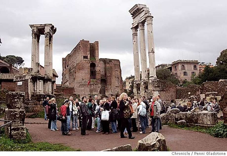 Visitors to the Forum in Rome, shown here with a tou group in 2005, will have to pay admission, starting March 10, 2008. Entrance will be included in a combined ticket that includes admission to the Colosseum and Palatine Hill. MANDATORY CREDIT FOR PHOTOG AND SF CHRONICLE/NO SALES-MAGS OUT Photo: Penni Gladstone