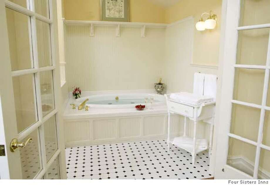 Some bathrooms at the 12-room Healdsburg Inn on the Plaza come with jet-spa tubs; others have shower stalls. Photo: Four Sisters Inns