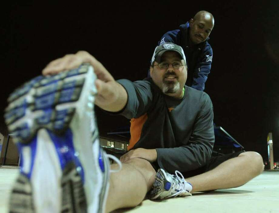 Pastor Danny Price of Hope Community Church, bottom, is working to lose weight with the help of Sherman Youngblood, who is training him. Feb. 9, 2012. Billy Calzada / San Antonio Express-News Photo: Billy Calzada, San Antonio Express-News / San Antonio Express-News