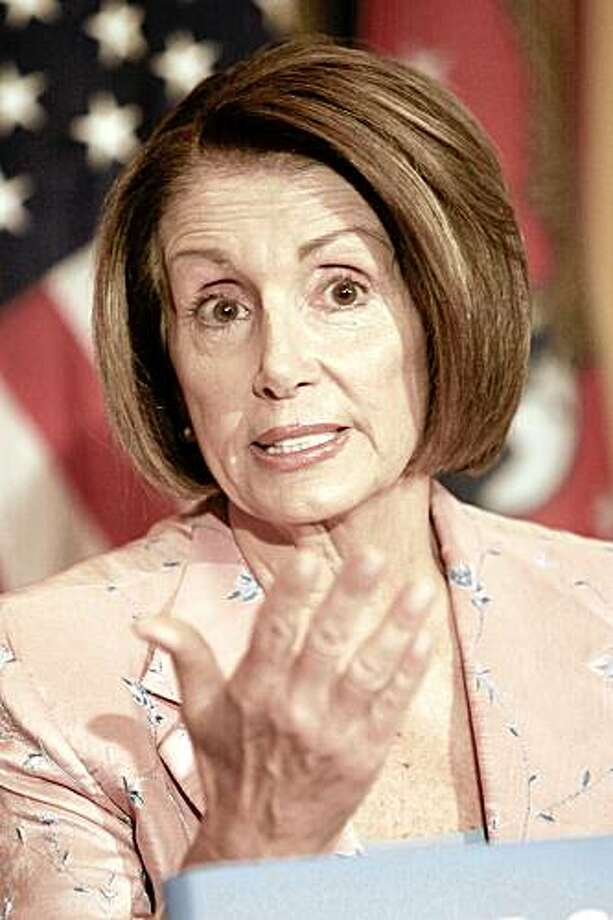 House Speaker Nancy Pelosi of Calif. gestures during her weekly news conference, Thursday, July 23, 2009, on Capitol Hill in Washington. (AP Photo/Lauren Victoria Burke) Photo: Lauren Victoria Burke, AP