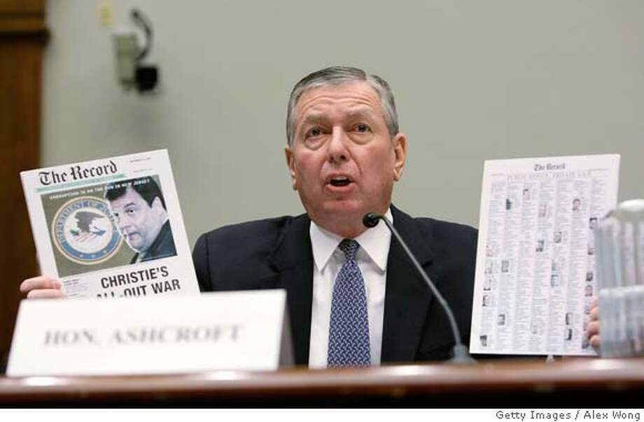 ###Live Caption:WASHINGTON - MARCH 11: Former U.S. Attorney General John Ashcroft holds up copies of The Record newspaper as he testifies during a hearing before the Subcommittee on Commercial and Administrative Law of the House Judiciary Committee March 11, 2008 on Capitol Hill in Washington, DC. Ashcroft was to testify on a multi-million-dollar contact which was awarded to his lobbying firm by the Justice Department to monitor a settlement between an Indiana medical equipment company and a prosecutor. (Photo by Alex Wong/Getty Images)###Caption History:WASHINGTON - MARCH 11: Former U.S. Attorney General John Ashcroft holds up copies of The Record newspaper as he testifies during a hearing before the Subcommittee on Commercial and Administrative Law of the House Judiciary Committee March 11, 2008 on Capitol Hill in Washington, DC. Ashcroft was to testify on a multi-million-dollar contact which was awarded to his lobbying firm by the Justice Department to monitor a settlement between an Indiana medical equipment company and a prosecutor. (Photo by Alex Wong/Getty Images)###Notes:Former Attorney General Ashcroft Attends House Judiciary Hearing###Special Instructions: Photo: Alex Wong