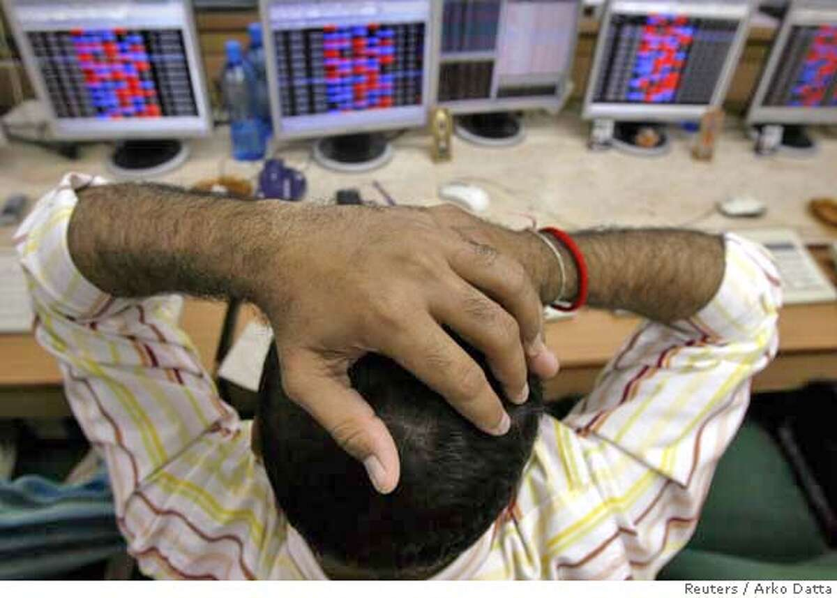 ###Live Caption:A stock broker reacts while trading at a brokerage firm in Mumbai March 3, 2008. Indian shares fell more than 5 percent on Monday, their biggest percentage drop in six weeks, as investors took fright from shaky global markets that slid on U.S. recession worries and more writedowns in the financial sector. REUTERS/Arko Datta (INDIA)###Caption History:A stock broker reacts while trading at a brokerage firm in Mumbai March 3, 2008. Indian shares fell more than 5 percent on Monday, their biggest percentage drop in six weeks, as investors took fright from shaky global markets that slid on U.S. recession worries and more writedowns in the financial sector. REUTERS/Arko Datta (INDIA)###Notes:Stock broker reacts while trading at a brokerage firm in Mumbai###Special Instructions:0