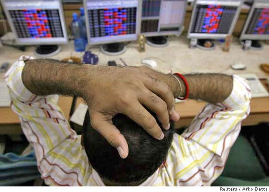 ###Live Caption:A stock broker reacts while trading at a brokerage firm in Mumbai March 3, 2008. Indian shares fell more than 5 percent on Monday, their biggest percentage drop in six weeks, as  investors took fright from shaky global markets that slid on U.S. recession worries and more writedowns in the financial sector. REUTERS/Arko Datta (INDIA)###Caption History:A stock broker reacts while trading at a brokerage firm in Mumbai March 3, 2008. Indian shares fell more than 5 percent on Monday, their biggest percentage drop in six weeks, as  investors took fright from shaky global markets that slid on U.S. recession worries and more writedowns in the financial sector. REUTERS/Arko Datta (INDIA)###Notes:Stock broker reacts while trading at a brokerage firm in Mumbai###Special Instructions:0 Photo: ARKO DATTA