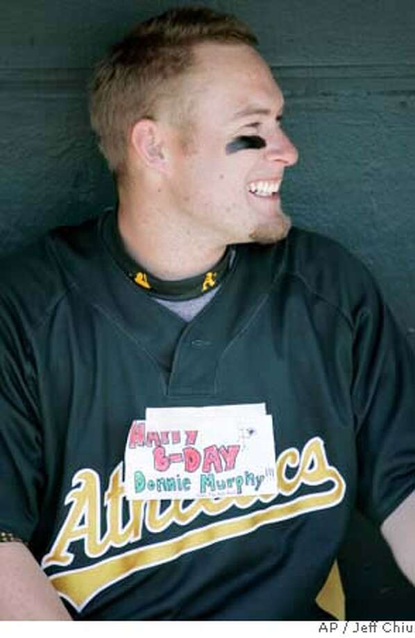Oakland Athletics' Daric Barton wears a birthday sign for teammate Donnie Murphy before a spring baseball game against the Los Angeles Angels in Tempe, Ariz., Monday, March 10, 2008. (AP Photo/Jeff Chiu) Photo: Jeff Chiu