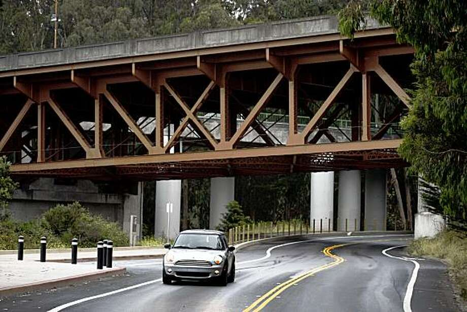 A commuter drives under Doyle Drive on Lincoln Boulevard in the Presidio near the Golden Gate Bridge in San Francisco, Calif., on Friday, July 24, 2009. Caltrans revealed to the bridge's Board of Directors its ambitious plans to replace the viaduct. Photo: Paul Chinn, The Chronicle