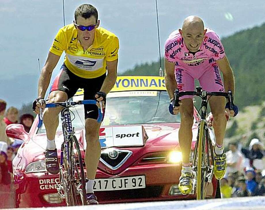 Marco Pantani, right, of Italy, sprints to beat overall leader Lance Armstrong, of Austin, Texas, and capture the 12th stage of the Tour de France cycling race between Carpentras and Mont Ventoux, southern France, Thursday, July 13, 2000. (AP Photo/Christophe Ena) Photo: Christophe Ena, AP