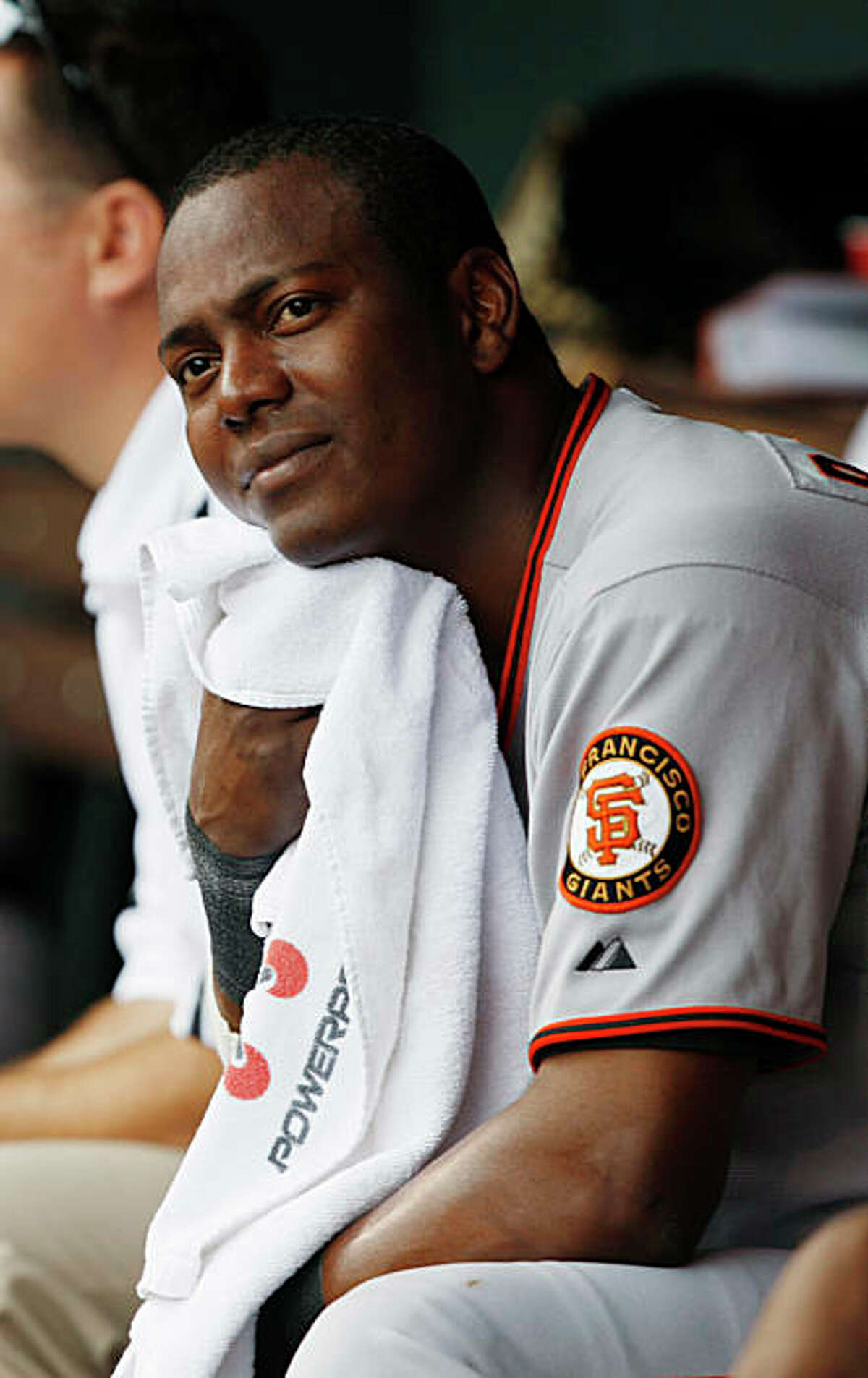 San Francisco Giants' Edgar Renteria checks the scoreboard while sitting in the dugout in the ninth inning of the Colorado Rockies' 4-2 victory in a baseball game in Denver on Sunday, July 26, 2009. (AP Photo/David Zalubowski)