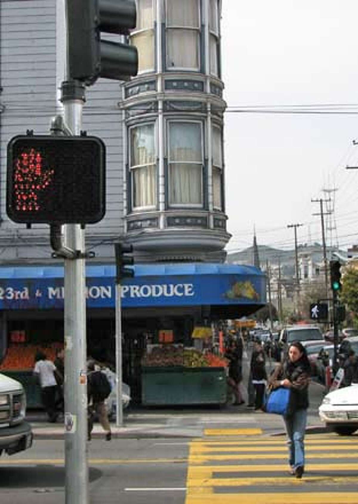 A pedestrian crossesat 23rd and Mission Streets in San Francisco in a file photo.