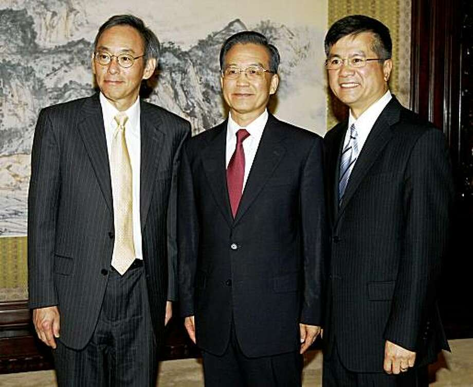 Chinese Prime Minister Wen Jiabao (C) poses with US Trade Secretary Gary Locke (R) and US Energy Secretary Steven Chu (L), before a meeting in Beijing on July 16, 2009.  Top US trade and energy officials were set to meet with Wen as the world's biggest emitters of greenhouse gases sought to step up cooperation on climate change. Locke and Chu, both ethnic Chinese, arrived here seeking to open China's markets to US green technology while urging Beijing to set hard targets on gas emissions. AFP PHOTO / Greg Baker / POOL (Photo credit should read GREG BAKER/AFP/Getty Images) Photo: Greg Baker, AFP/Getty Images