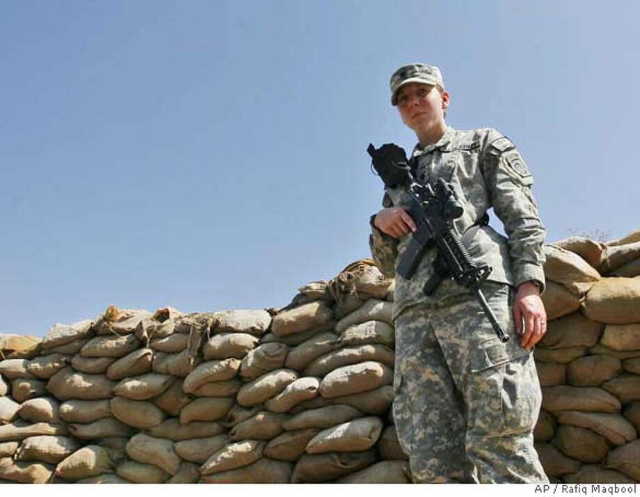 **RETRANSMITTING TO CORRECT BROWN WILL BECOME THE SECOND WOMAN SINCE WORLD WAR II TO RECEIVE THE SILVER STAR NOT THE FIFTH** Spc. Monica Lin Brown from Lake Jackson Texas of 82 Air borne stands guard at a forwarded operating base in Khost, Afghanistan, Saturday, March 8, 2008. Brown, will be the second female soldier awarded the Silver Star since World War II, for her role in Afghanistan. (AP Photo/Rafiq Maqbool) Photo: Rafiq Maqbool