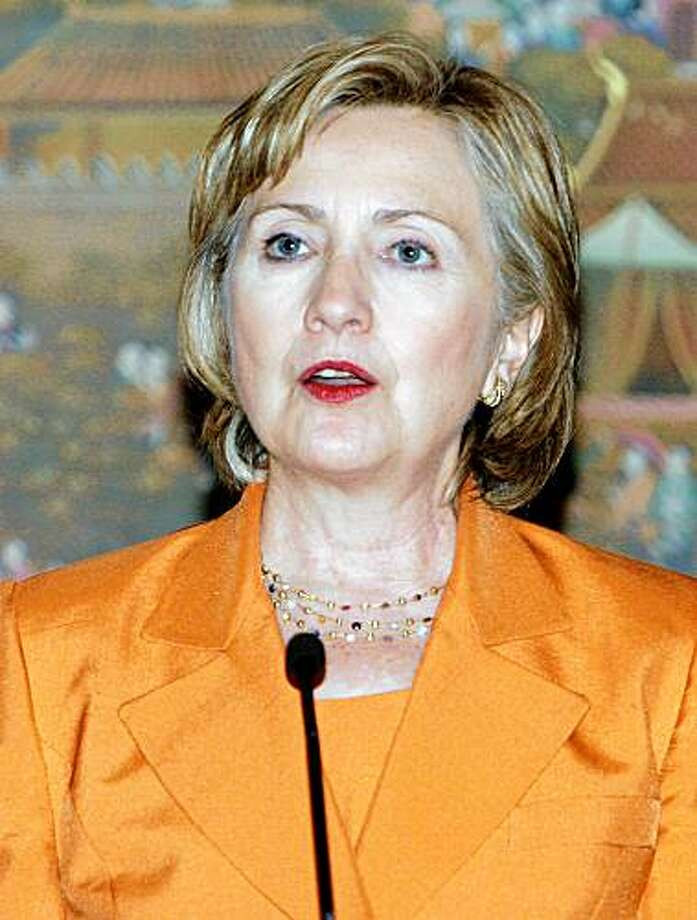 US Secretary of State Hillary Clinton (L) responds to a reporters question during a press conference at the government house in Bangkok, on July 21, 2009. Clinton arrived in Thailand for a regional security conference focusing on the North Korean nuclear threat, Myanmar's rights record and terrorism. Following a meeting with Thailand's Prime Minister Abhisit Vejjajiva in Bangkok, Clinton is expected to travel to Phuket on July 22 for the Association of Southeast Asian Nations Regional Forum (ARF), which groups the regional bloc with the United States and 16 other countries.  AFP PHOTO/POOL/SAKCHAI LALIT (Photo credit should read SAKCHAI LALIT/AFP/Getty Images) Photo: Sakchai Lalit, AFP/Getty Images