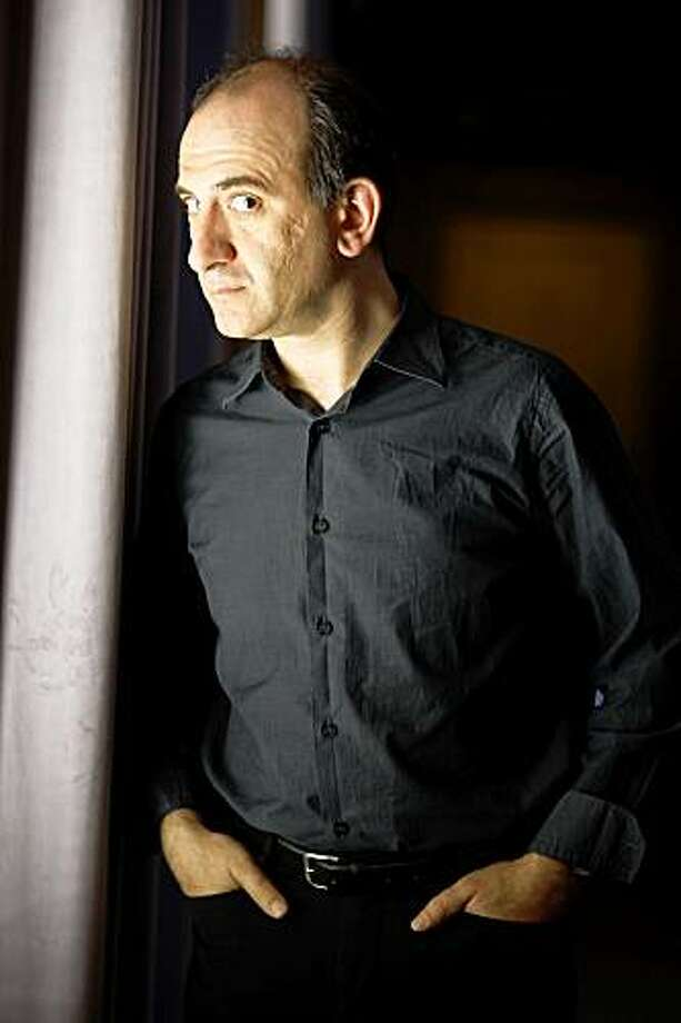 "British writer, comic and filmmaker Armando Iannucci has made a movie, ""In the Loop,"" that satirizes British and American governments going to war.  He is promoting his film in San Francisco, Calif., on Wednesday, April 29, 2009. Photo: Liz Hafalia, The Chronicle"