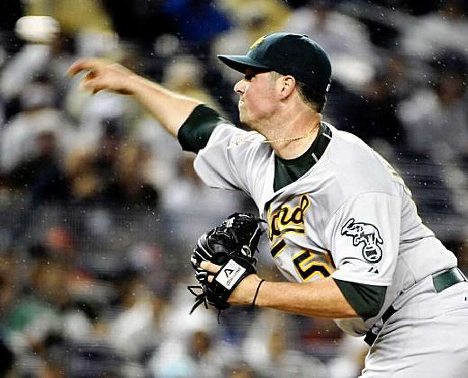 Oakland Athletics pitcher Vin Mazzaro delivers the ball to the New York Yankees during the first inning of a baseball game Thursday, July 23, 2009, at Yankee Stadium in New York. (AP Photo/Bill Kostroun) Photo: Bill Kostroun, AP